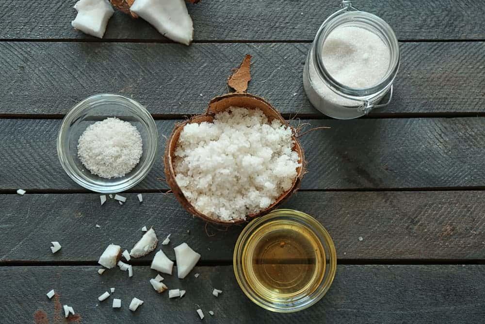 Natural scrub ingredients on wooden background