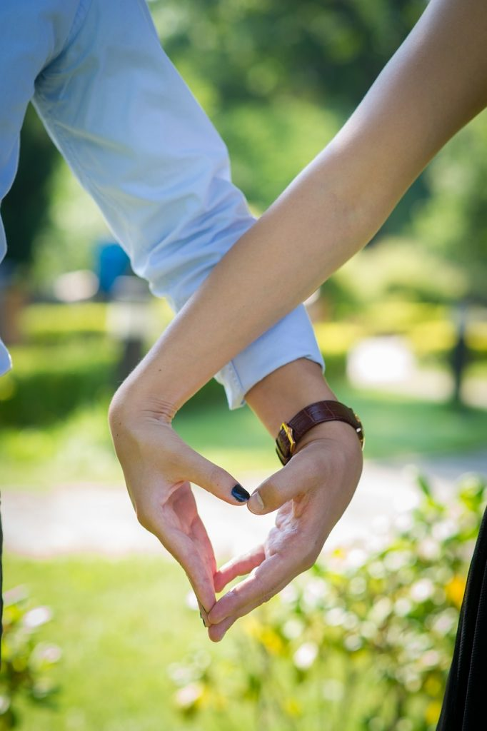 couple making heart with their hands