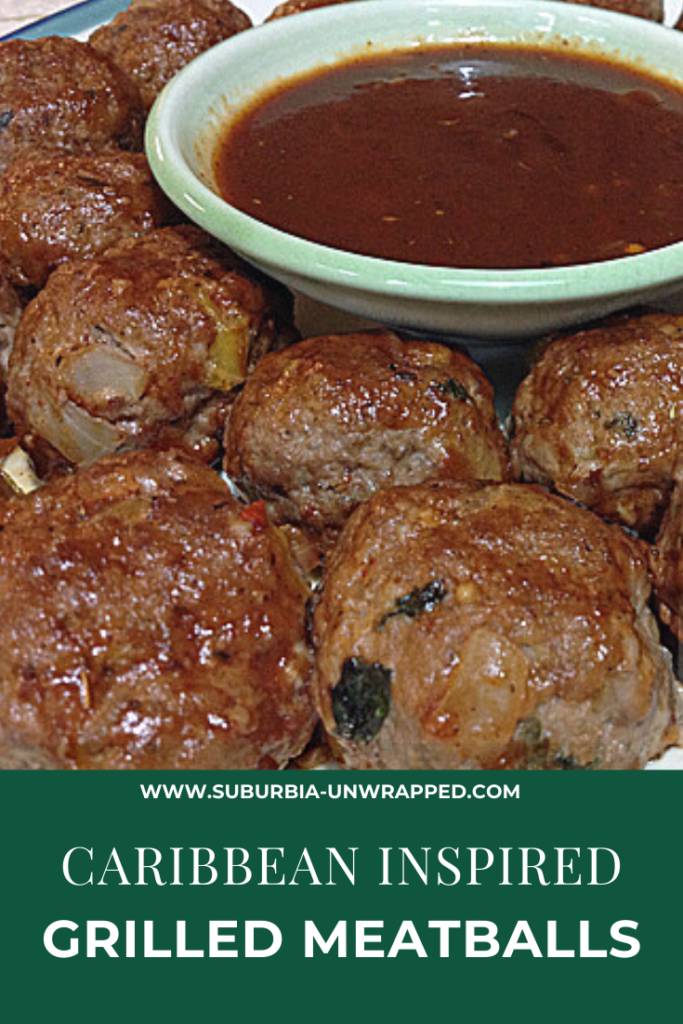 Caribbean meatballs on a plate with a bowl of jerk seasoning dipping sauce