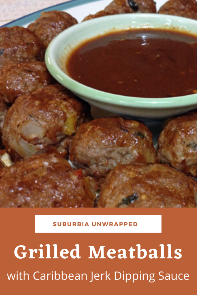 Grilled Meatballs on a plate with a bowl of Jerk Dipping Sauce