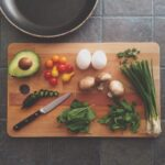 avocado and salad ingredients on a cutting board
