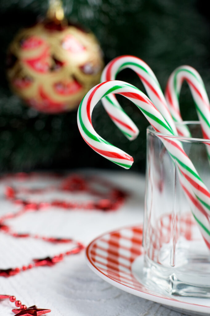 Christmas Candy Canes in a glass and Christmas Tree