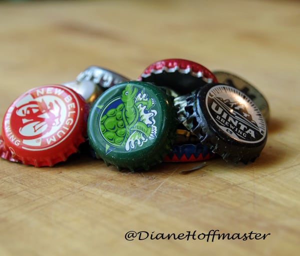 pile of old bottle caps on wooden background