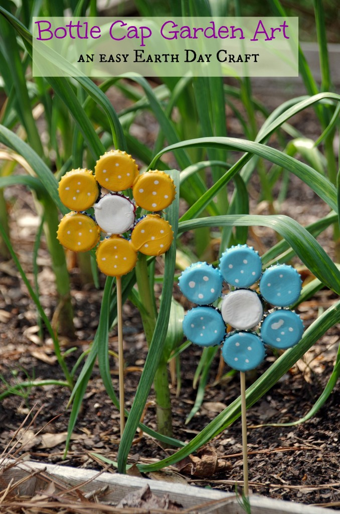 two bottle cap flowers in a garden
