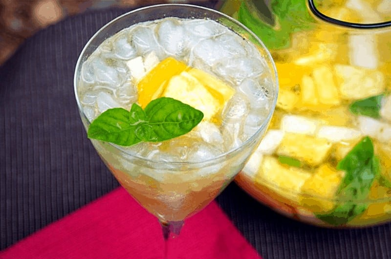 easy white sangria with fruit and herbs