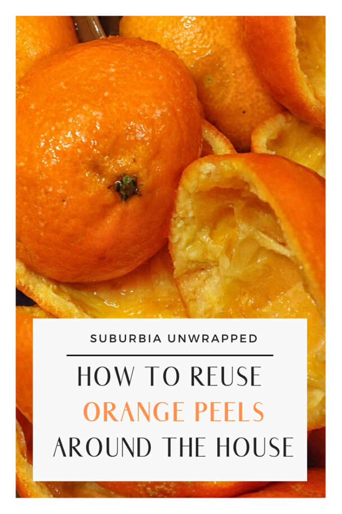 Leftover orange peels with text How to Reuse Orange Peels Around the House