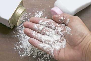 baby powder sprinkled on a hand