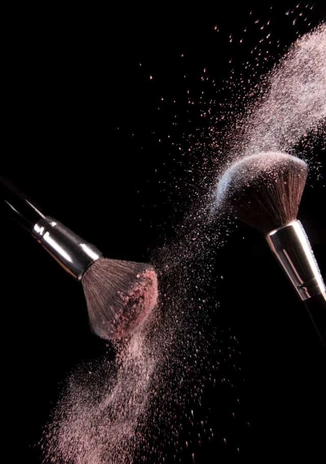 makeup brushes with powder on them