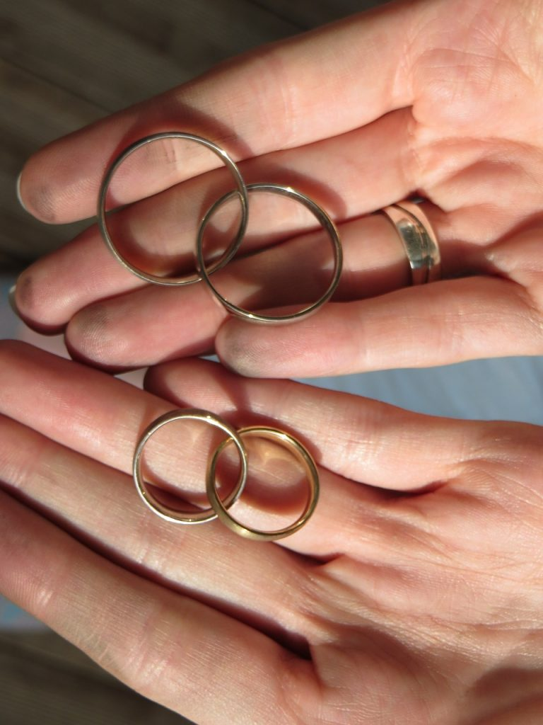 gold rings that need cleaning in a person's hands