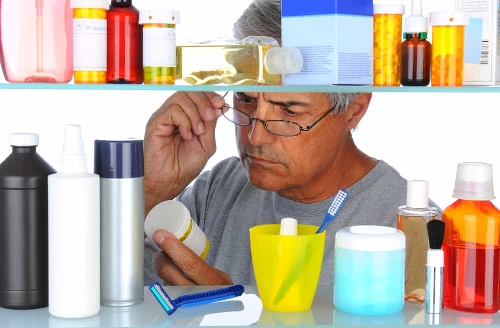Middle aged man in front of medicine cabinet