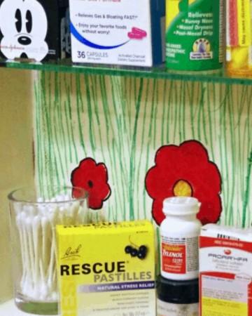 Organized medicine cabinet with medicine
