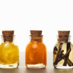 Lemon, orange and vanilla extracts in glass bottles