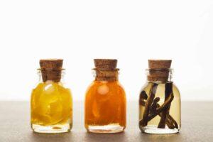 Lemon, orange and vanilla extracts in glass bottles