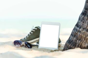close-up digital tablet on the beach