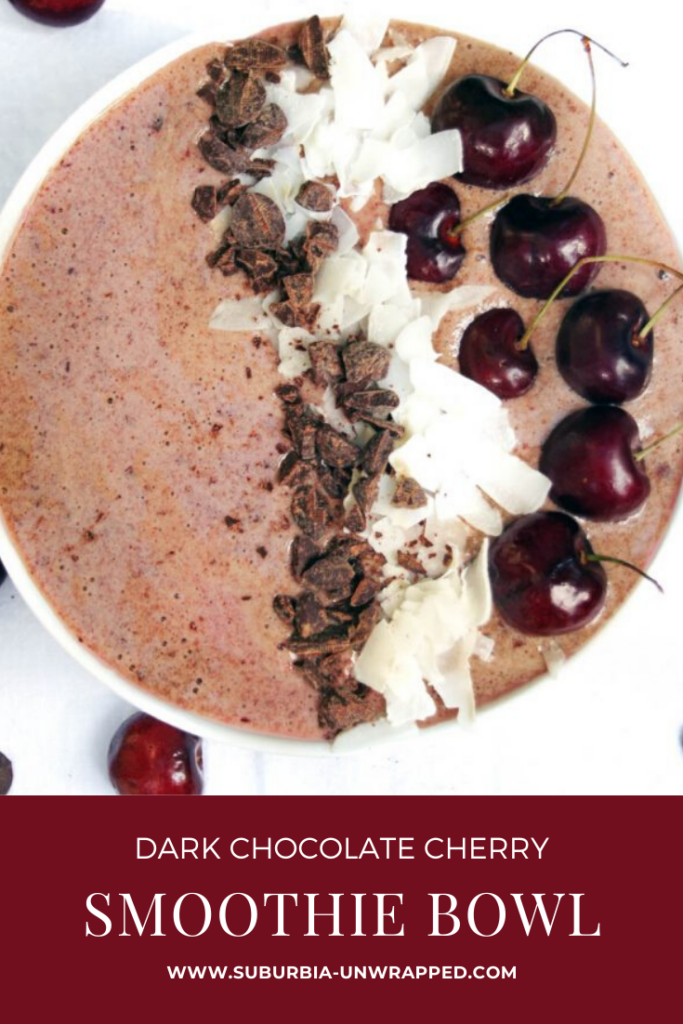 Dark Chocolate Cherry Smoothie Bowl on white background with fresh cherries next to it