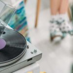 record player with girl in polka dot socks in background
