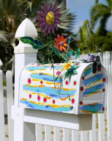 Fun artistic mail box with spring flowers decoration
