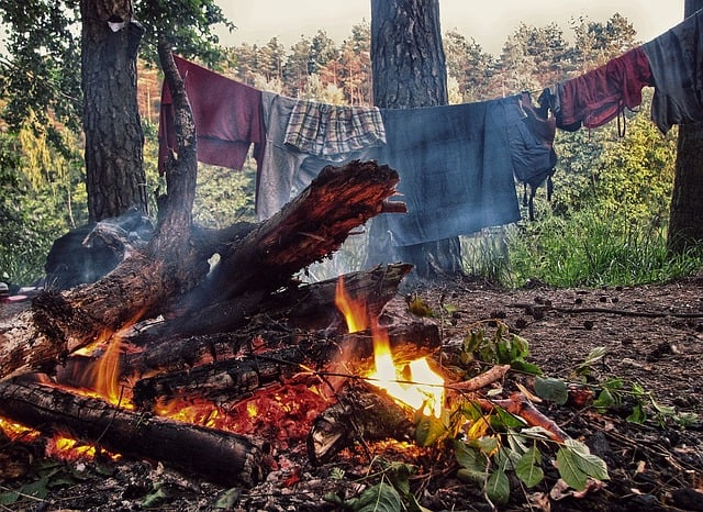 camping clothes by a campfire
