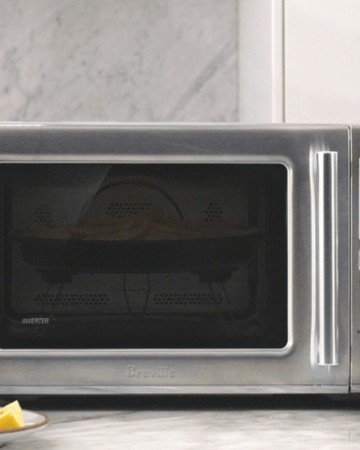 Microwave Oven on Counter next to plates of food