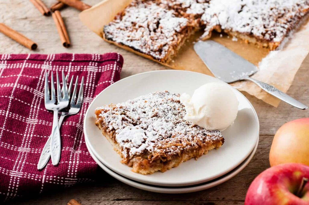 grated apple tart on plate with icecream