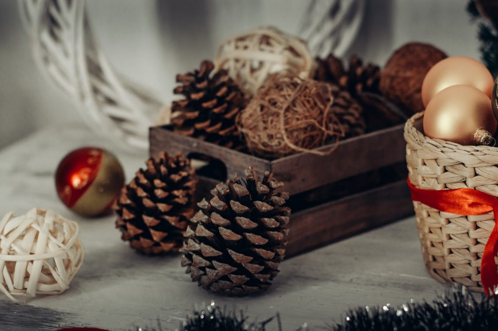 pine cones in natural basket for Christmas decorating