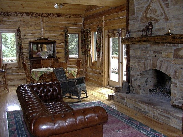 fireplace and leather couch in rustic living room