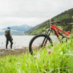 man and bicycle on beach for outdoor exercise