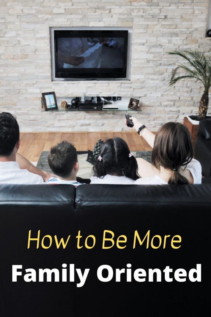 family watching movie on couch with text overlay 'How to Be More Family Oriented'