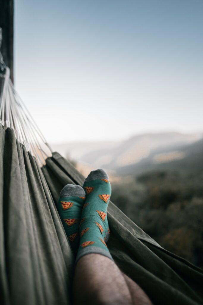 canvas hammock with mens feet in socks