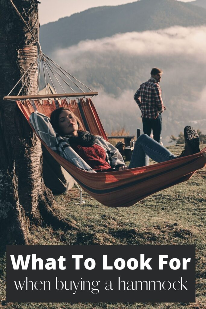 woman in woods in hammock with text overlay what to look for when buying a hammock