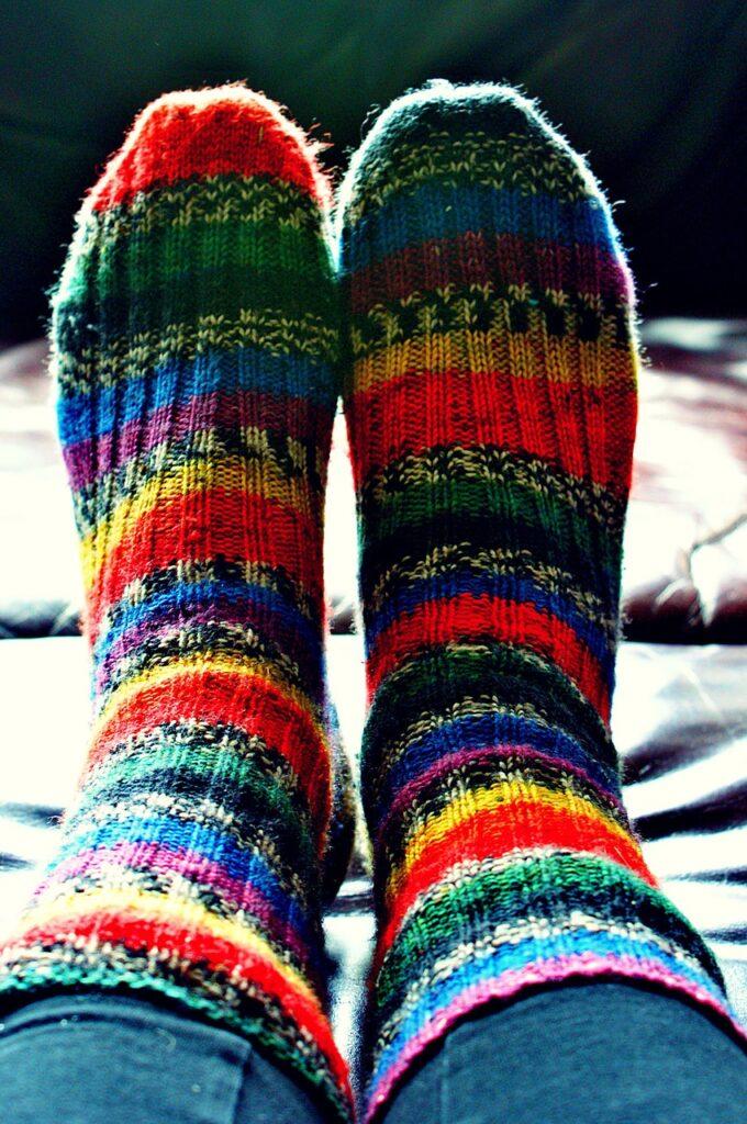 feet with cute striped socks on them