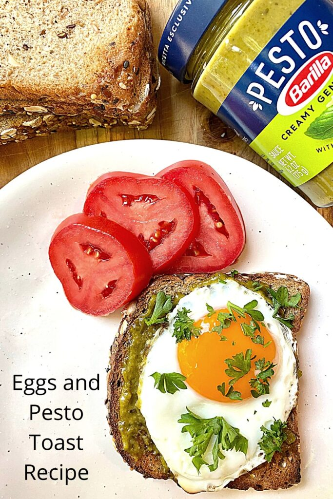 fried egg on pesto toast with fresh tomatoes and text overlay 'Eggs and Pesto Toast Recipe'